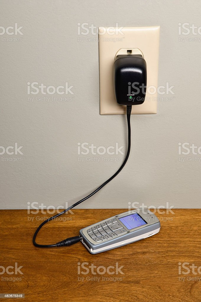 Cell Phone With Charger stock photo