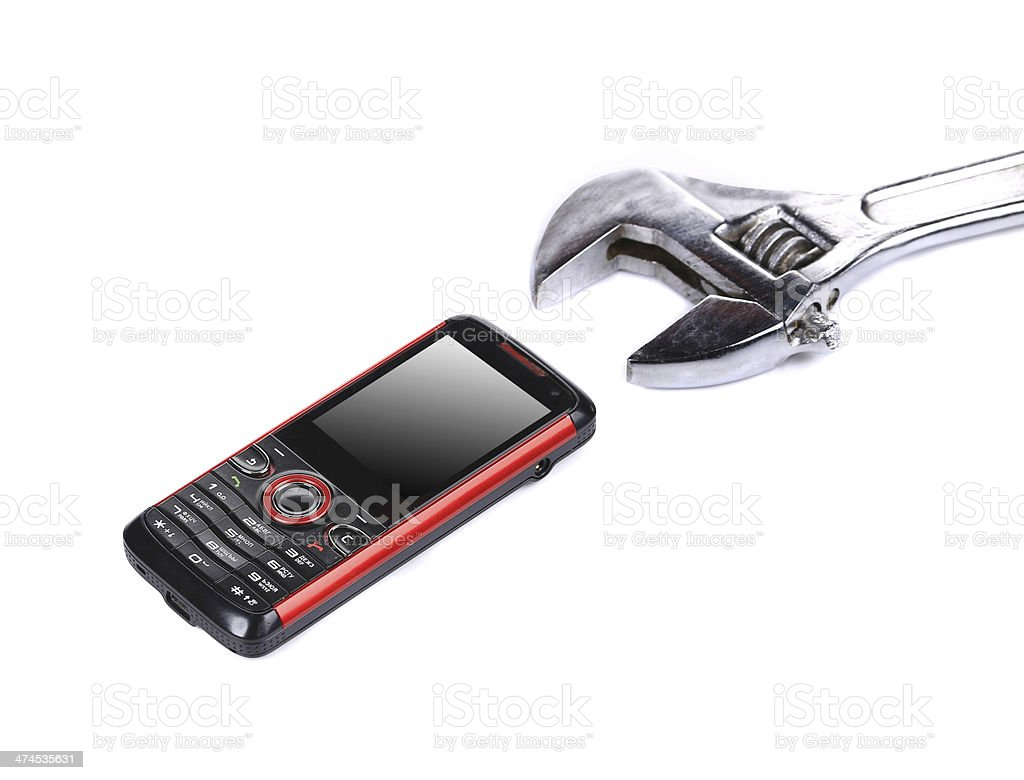 Cell phone with wrench. stock photo