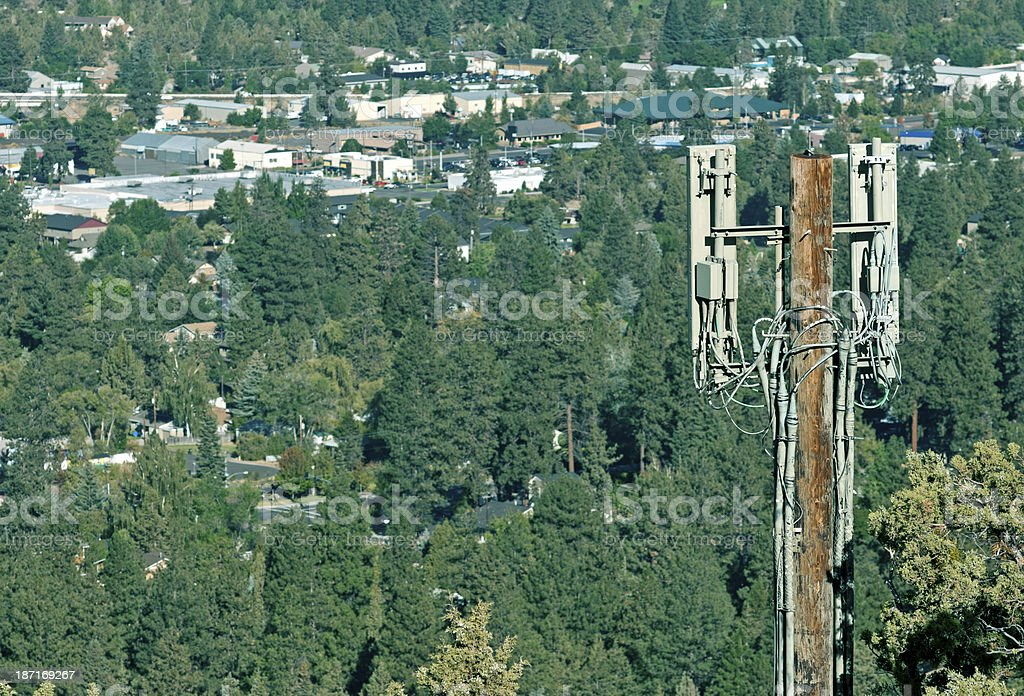 Cell site on butte above city in central Oregon royalty-free stock photo