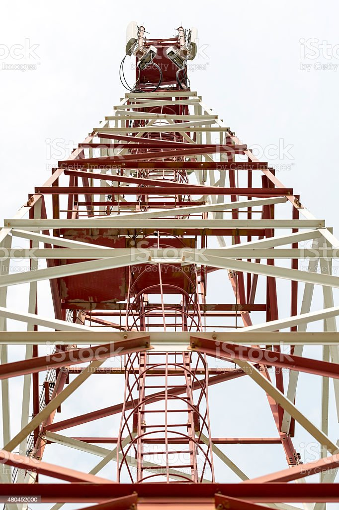 Cell tower and antenna GSM,CDMA. Seen from below stock photo