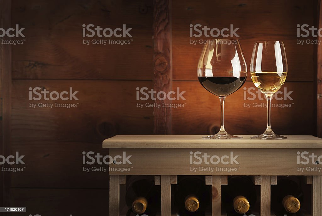 Cellar with Racks and glasses of White & Red Wine Horizontal royalty-free stock photo