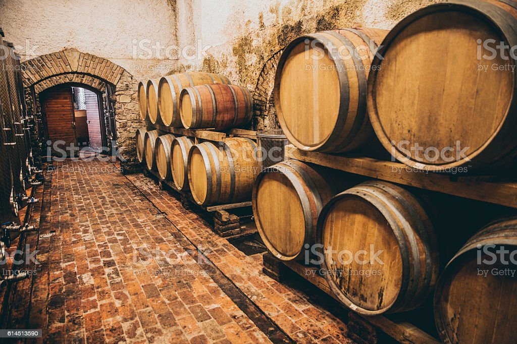 Cellar with Traditional Wooden Barrels stock photo