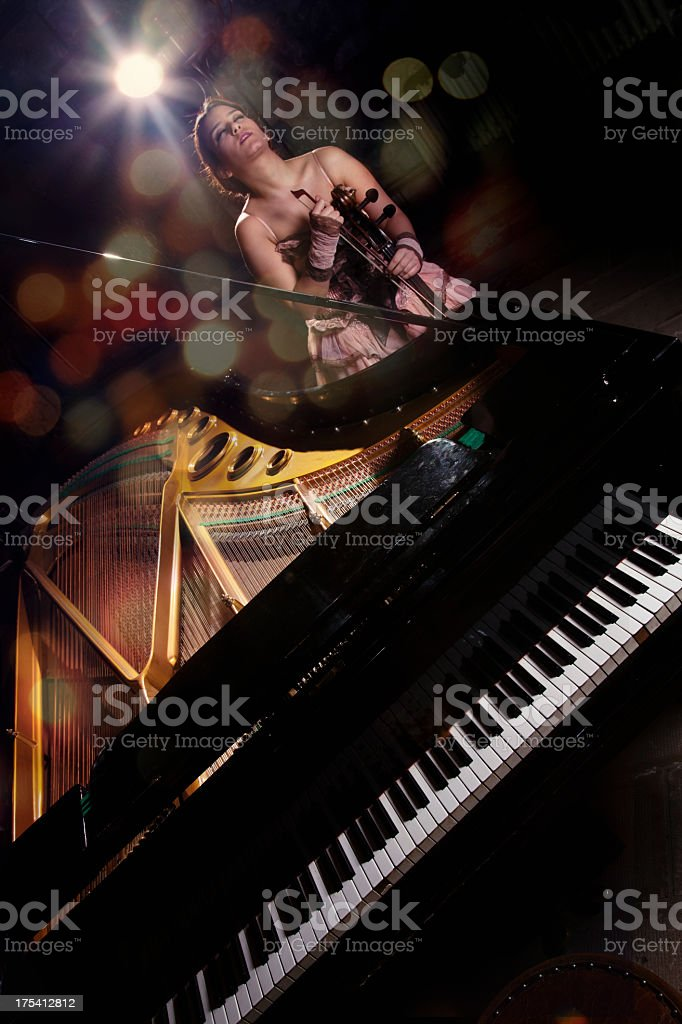 cellist and grand piano royalty-free stock photo