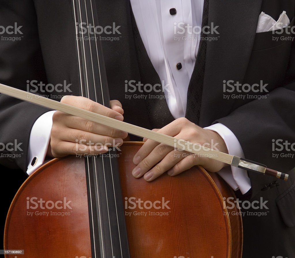 Cellist Holding Cello and Bow, Musician in Tuxedo for Concert stock photo
