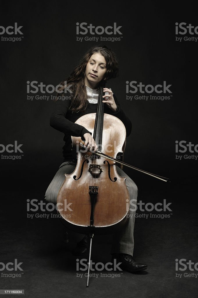 cellist with closed eyes stock photo