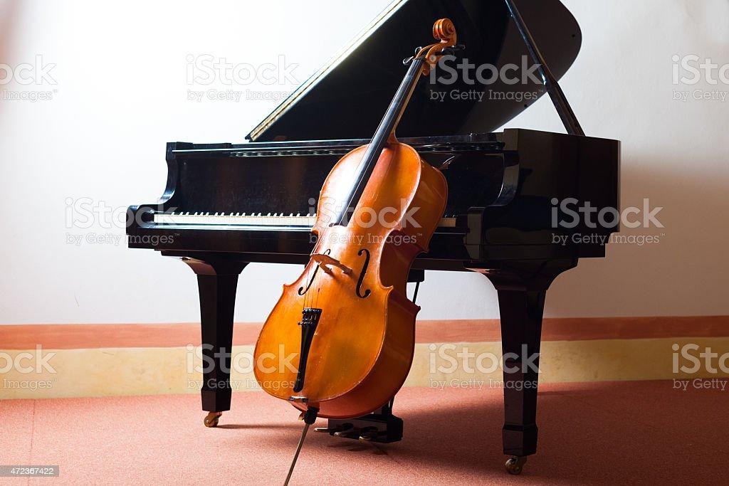 Cello and a piano representing classical music stock photo