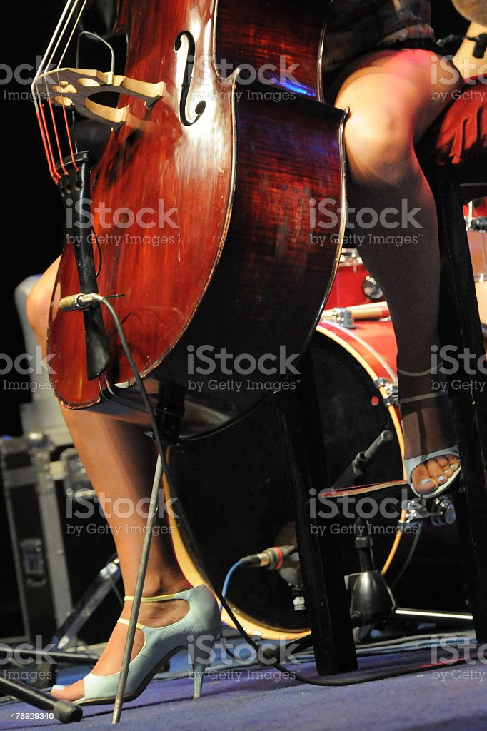 Cello and legs stock photo