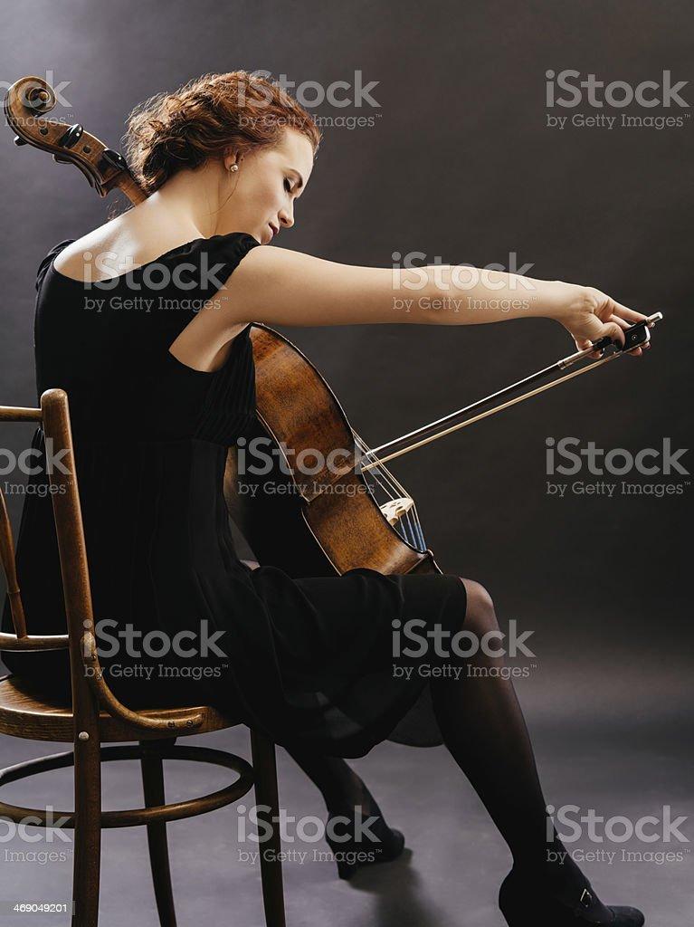 Cello player enjoying her music stock photo