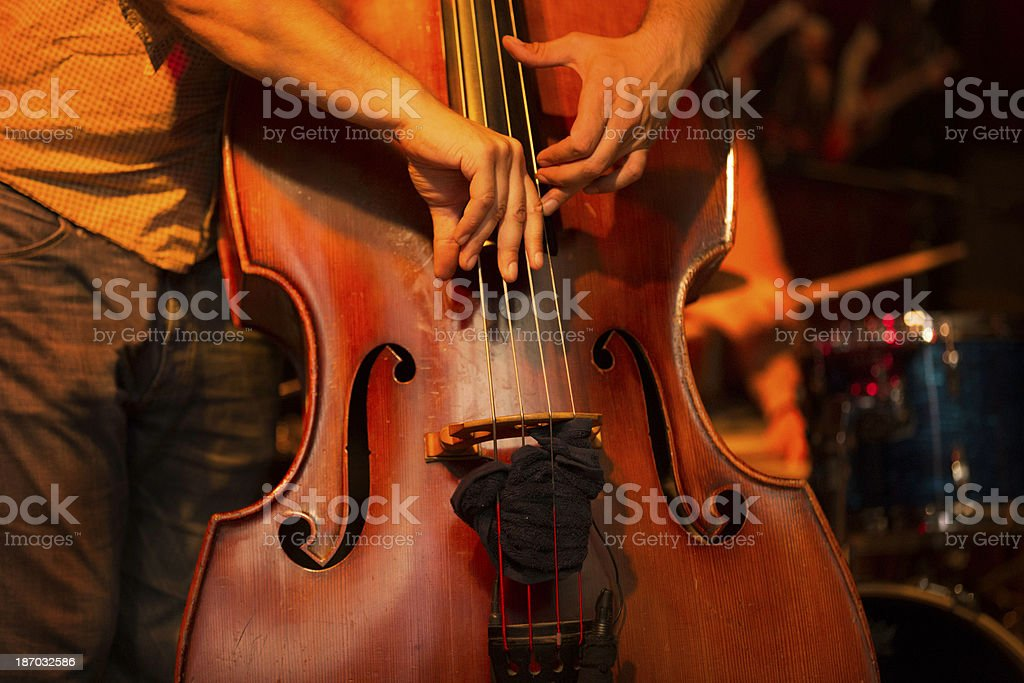 Cello player on stage royalty-free stock photo