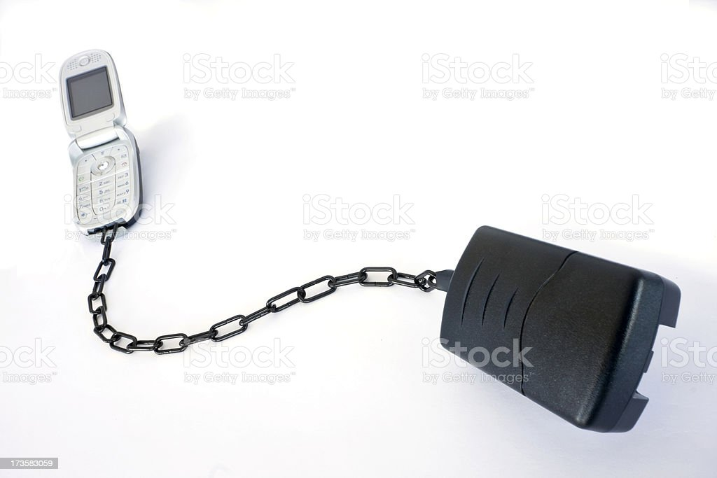 Cellphone Chained to Power 1 royalty-free stock photo