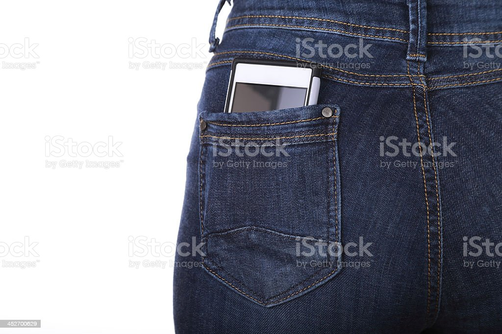 Cellphone in her back pocket stock photo