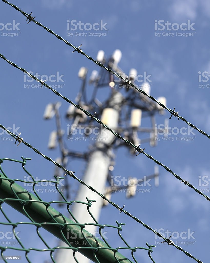 Cellphone tower showing multiple antennas against a blue sky. royalty-free stock photo