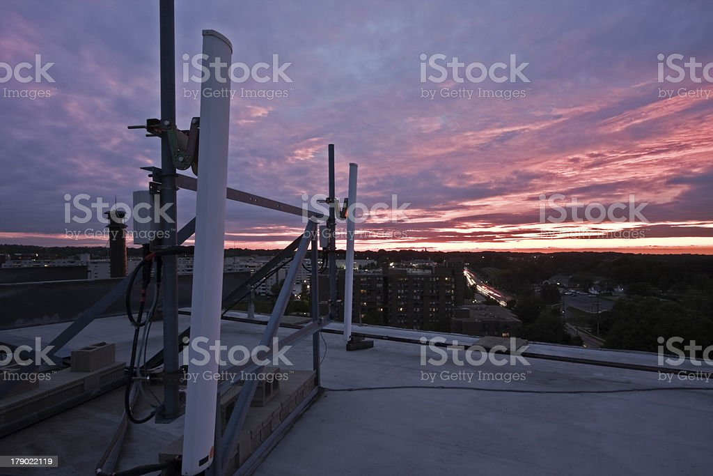 Cellular antennas seen during sunset royalty-free stock photo