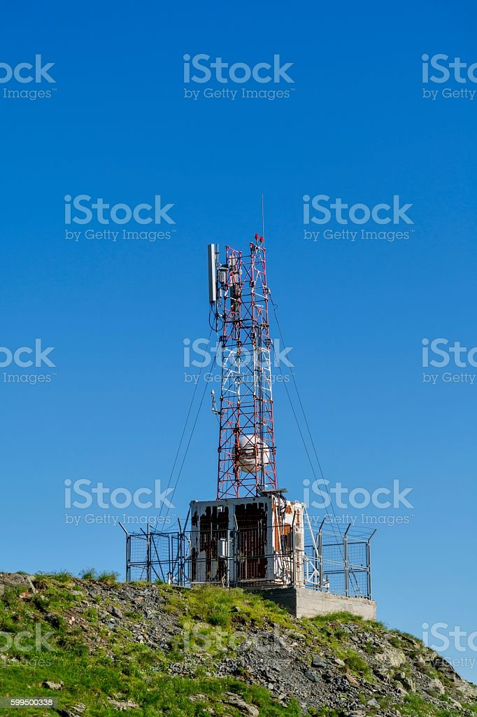 Cellular communications antennas in the top of the mountains stock photo