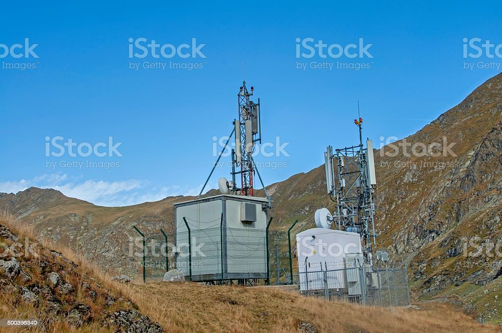 Cellular, microwave and telecom communications antennas stock photo