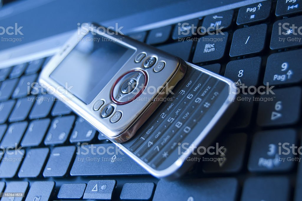 Cellular on a laptop royalty-free stock photo