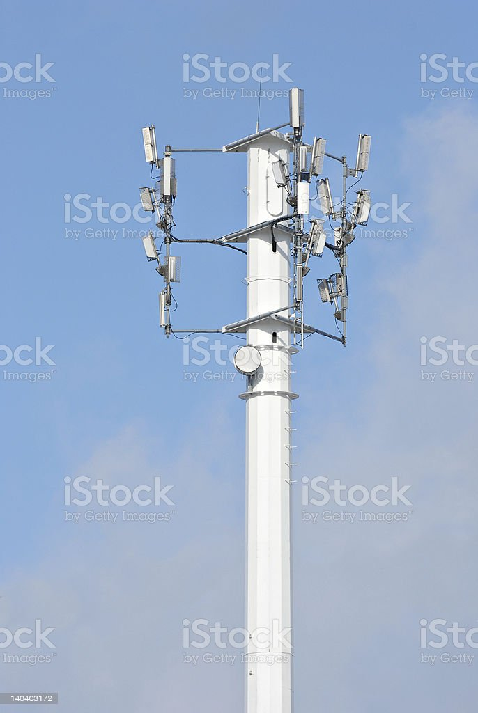 Cellular phone and telecommunication tower stock photo
