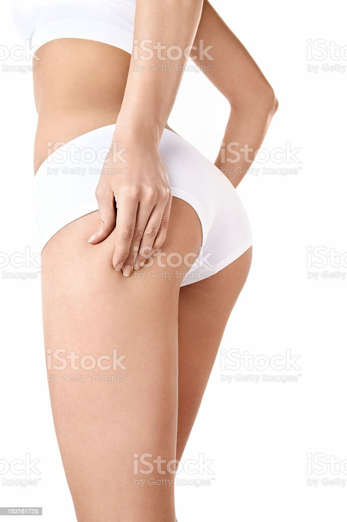 Cellulite free woman's backside in front of white background royalty-free stock photo