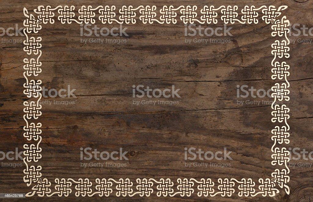 celtic border knotwork ornament design wooden background stock photo