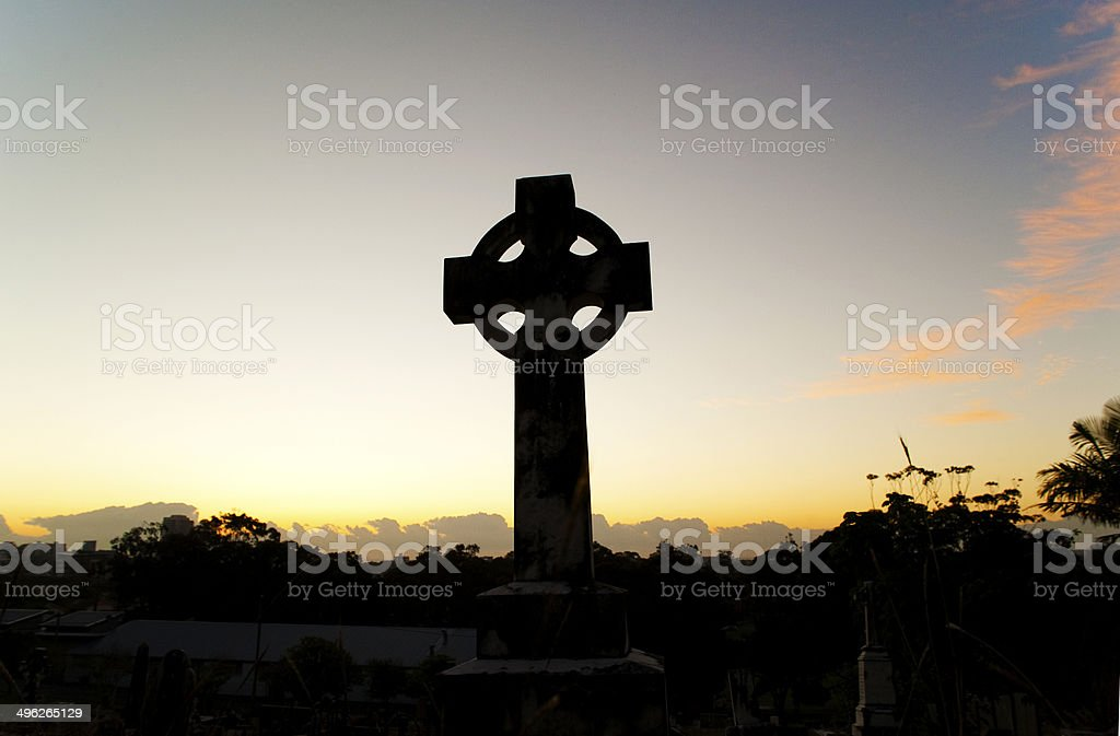 Celtic cross at sunrise stock photo