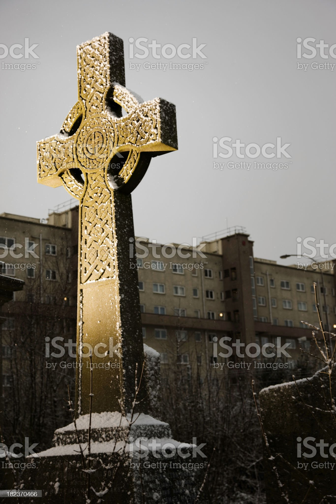 Celtic Cross In An Urban Graveyard royalty-free stock photo