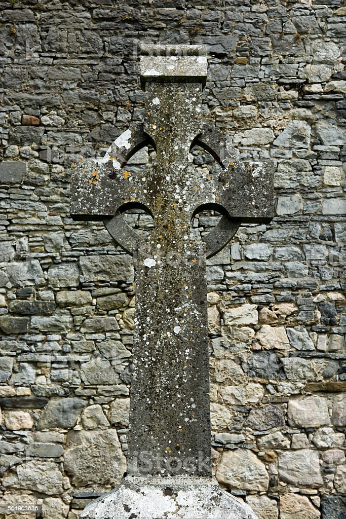 Celtic Cross in Front of Old Stone Wall stock photo