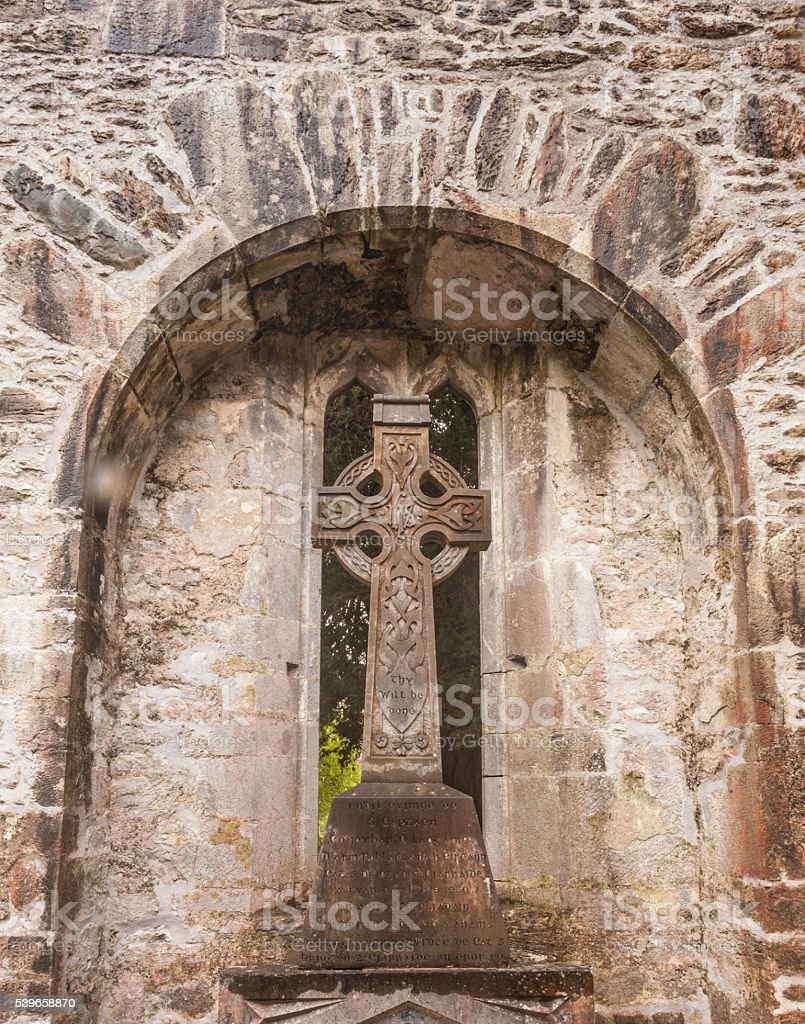 Celtic Cross in Irish Castle stock photo