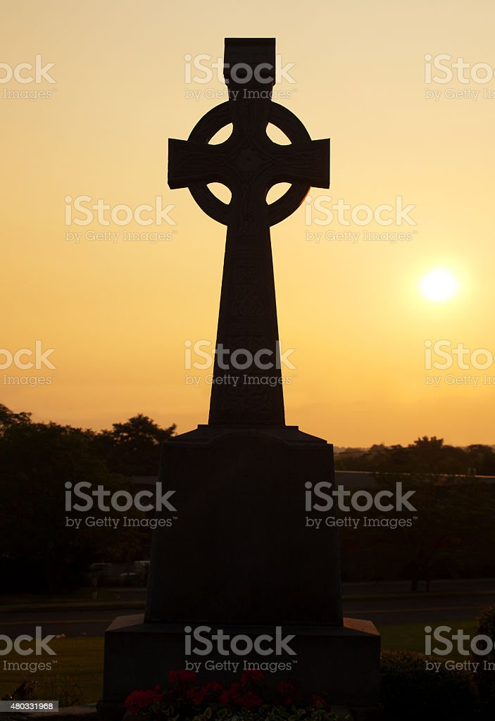 Celtic cross in silhouette stock photo