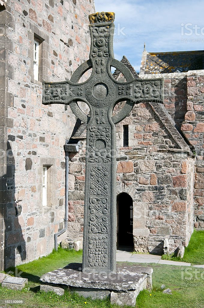 Celtic cross standing near old church royalty-free stock photo