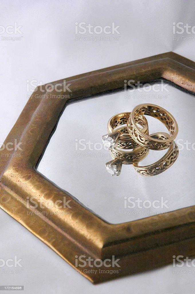 Celtic Wedding Rings Reflected stock photo