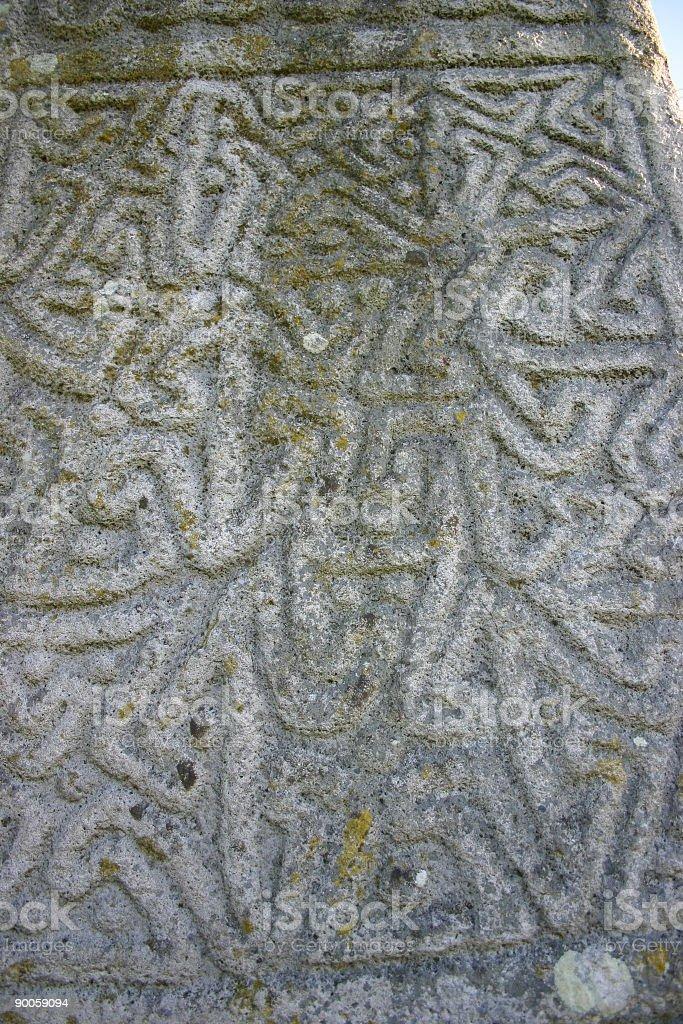 Celtic Writing on Celtic Cross royalty-free stock photo