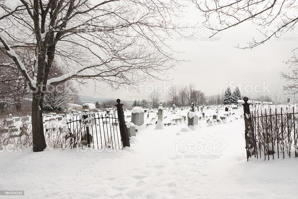 Cememtery Entrance in Winter Snow with Exit Only Sign stock photo