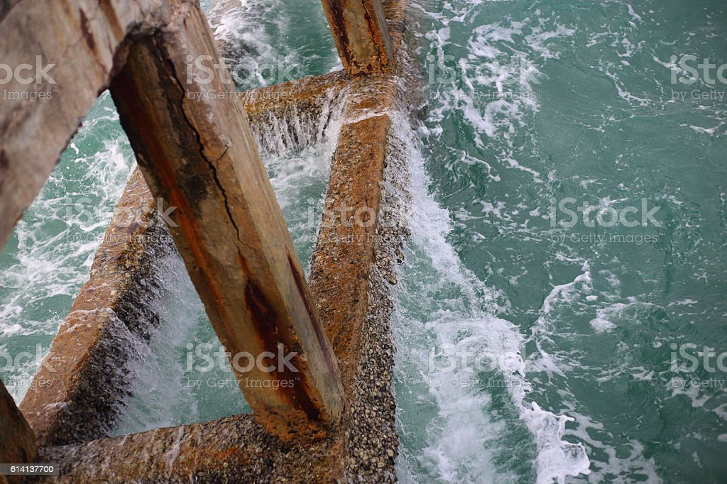 Cement bridge pier and wave in Mae Rumphueng Beach stock photo