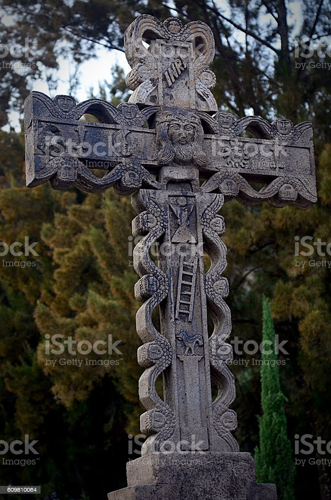 cement crucifix outside stock photo
