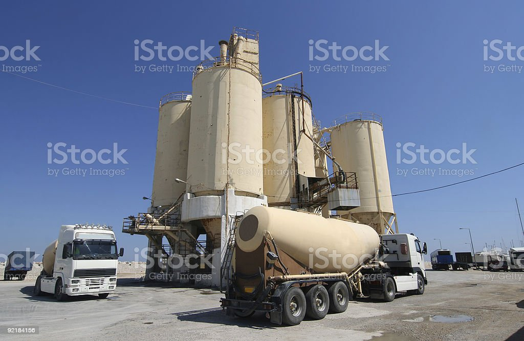Cement Factory and Trucks stock photo