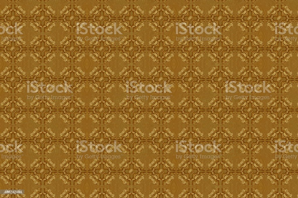 Cement gold Crafts wall in the temple close from thailand stock photo