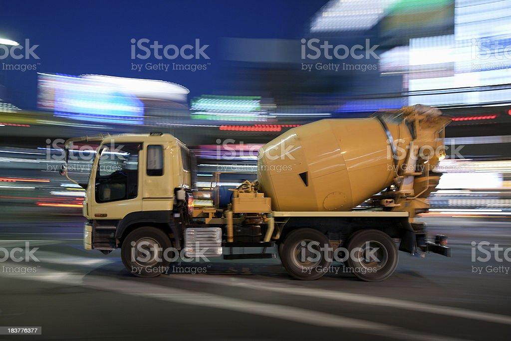 Cement mixer speeds through Tokyo at night stock photo