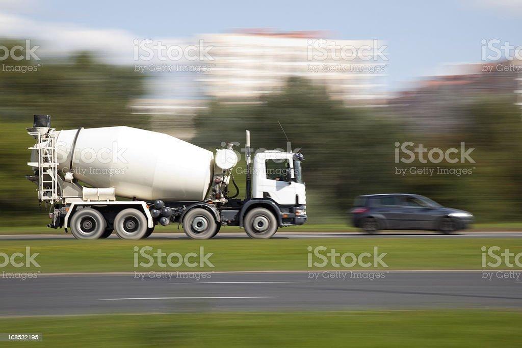Cement mixer truck motion stock photo
