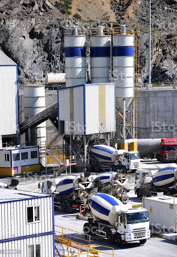Cement Mixer Trucks at a Ready Mix Cement Plant stock photo