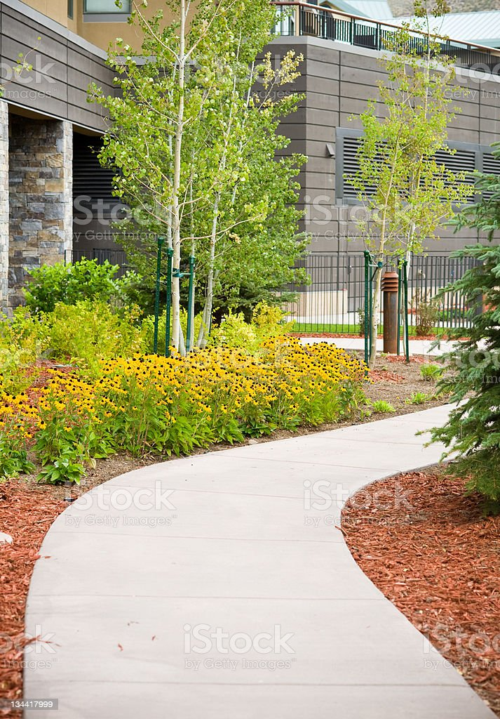 Cement Path with Scenic Flower Garden and Landscaping royalty-free stock photo