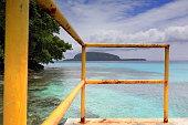 Cement pier-yellow metal railing. Champagne Beach-Espiritu Santo island-Vanuatu. 7401