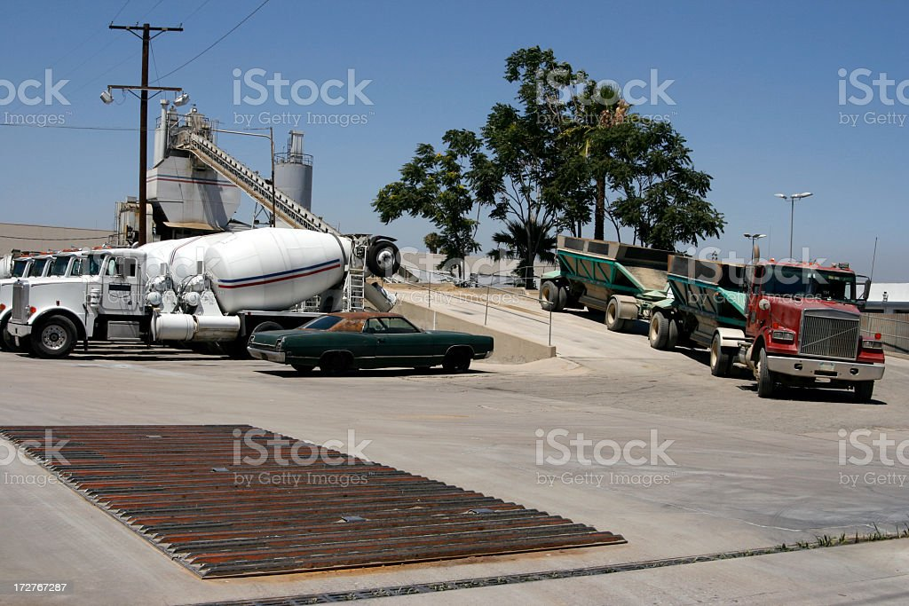Cement Plant with Cent Trucks Trucking Transporting Transportation Delivery royalty-free stock photo