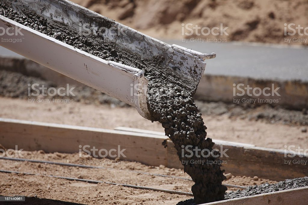 Cement Pouring from a Mixer Truck Chute stock photo