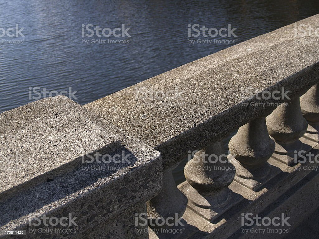 Cement Railing Over Water royalty-free stock photo