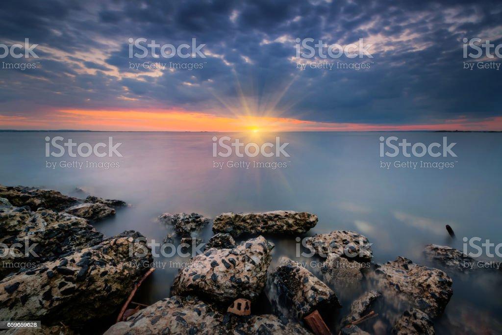 Cement rock seascape sunset stock photo
