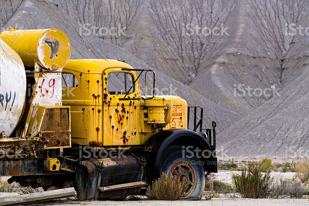 Cement Truck Abandoned and Shot Up with Bullets stock photo