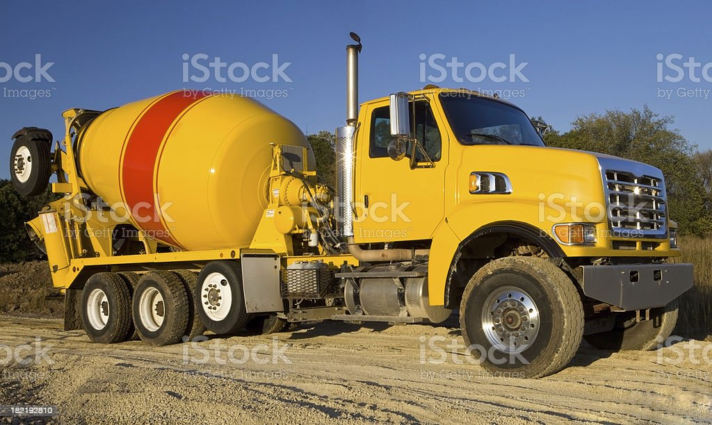 Cement Truck Leaving a Construction Site stock photo