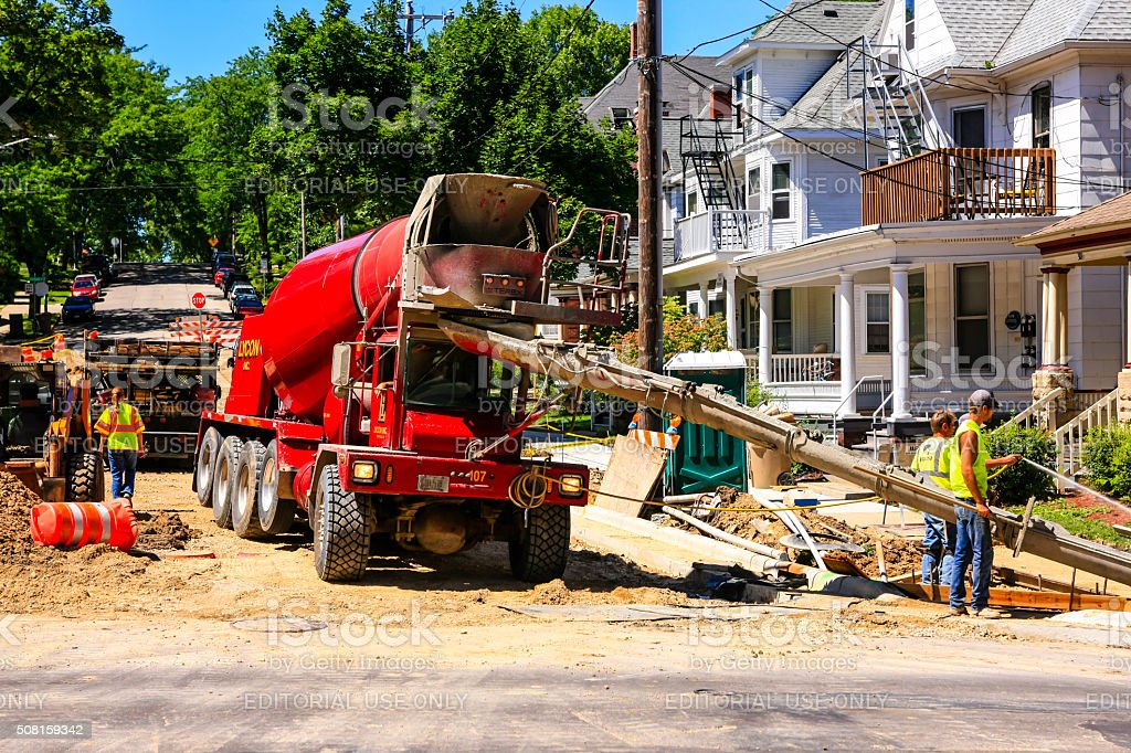 Cement truck unloading its cargo at a construction site stock photo