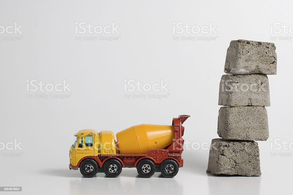 Cement truck with concrete blocks royalty-free stock photo