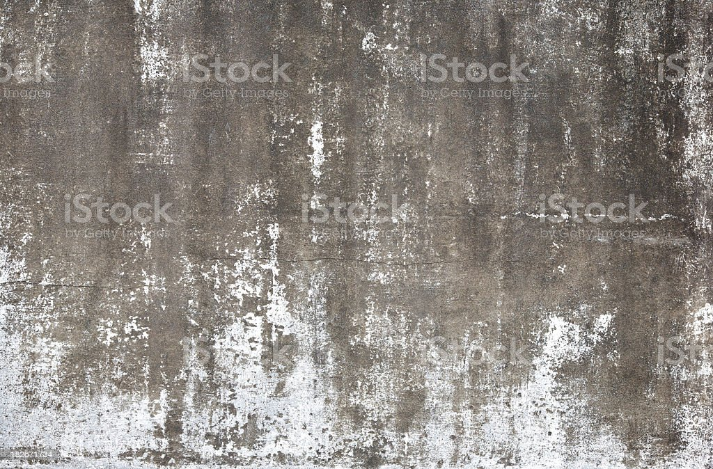 A cement wall that is weathered away royalty-free stock photo